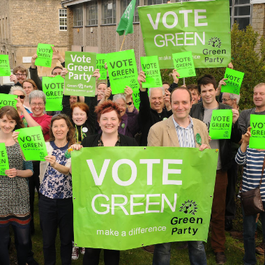 """bath nes greens group photo with """"vote Green"""" banners"""